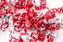 Closeup of curly gift ribbons in red, white and silver Royalty Free Stock Image