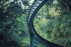 Closeup Curves of steel rails Background image is a forest garden royalty free stock photo