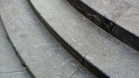 Closeup of curving staircase. High angle view of gentling curving concrete steps - an urban closeup Stock Photo