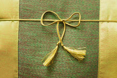 Closeup of  cushion with ribbon Royalty Free Stock Images