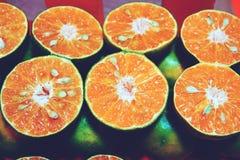 Closeup of cut oranges on a market stock images