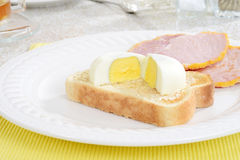 Closeup cut poached egg on toast Stock Photos