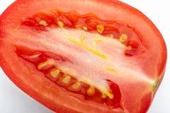 Closeup of Cut Tomato. Closeup of Cut San Marzano Tomato on white background Stock Image