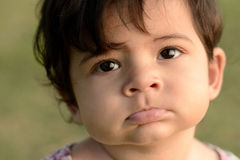 Closeup of cute adorable beautiful face of mixed race baby with Royalty Free Stock Photo