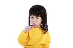 Closeup cute asian girl with a toothbrush in hand going to brush. Closeup cute asian girl in pajamas with a toothbrush in hand and brush teeth, oral health royalty free stock photo