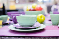 Closeup on cute green and purple dinnerware sold on display image Royalty Free Stock Photo