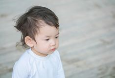 Closeup cute asian kid interest in something emotion with copy space Royalty Free Stock Photography