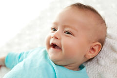 Closeup of a cute little baby smiling Royalty Free Stock Photography