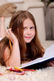 Closeup of cute little girl doing her homework Royalty Free Stock Photography
