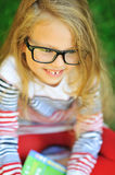 Closeup of cute little girl in glasses - outdoor Royalty Free Stock Photos