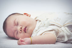 Closeup cute sleeping baby. Adorable baby girl, on white backgro Royalty Free Stock Image