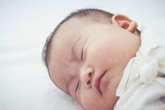 Closeup cute sleeping baby. Adorable baby girl, on white backgro Stock Photos