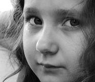 Closeup of a cute small girl. Black and white photo Royalty Free Stock Photo
