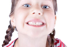 Closeup of a cute small girl showing her new tooth royalty free stock image