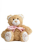 Closeup of a cute teddybear with a bow tie. Closeup of a cute teddybear with a pink bow tie, isolated on white background Royalty Free Stock Image