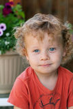 Closeup cute toddler. A closeup of a cute toddler with curly blond ringlets and blue eyes. Shallow DOF Royalty Free Stock Image