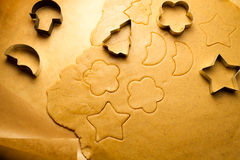 Closeup cutting of gingerbread cookies stock photography