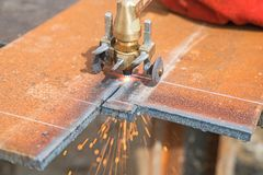 Closeup cutting plate steel with arc welder. Closeup cutting heavy plate steel with arc welder Royalty Free Stock Photography