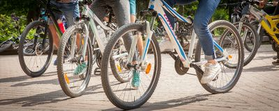 Closeup of cyclist man legs riding bike on outdoor trail in nature Stock Photos