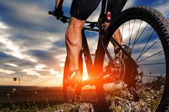 Closeup of cyclist man legs riding mountain bike. On outdoor trail in autumn forest Royalty Free Stock Images