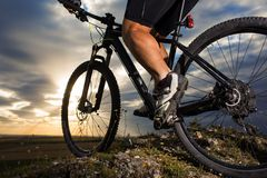 Closeup of cyclist man legs riding mountain bike. On outdoor trail in autumn forest Stock Images