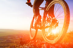 Closeup of cyclist man legs riding mountain bike on outdoor trail on hill Royalty Free Stock Photography