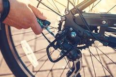 Closeup Cyclist Man& x27;s Hand Repairing Bicycle Wheel stock photos
