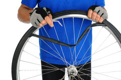 Cyclist Fixing Flat Tire Royalty Free Stock Images