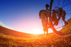 Closeup of a cyclist on a sport mountain bike. travel in countryside Royalty Free Stock Photos