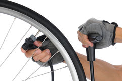 Cyclist Pumping up Tire Stock Images
