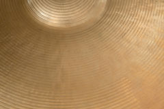 Closeup of cymbal. Closeup of gold colored cymbal on horizontal picture Royalty Free Stock Photos