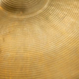 Closeup of cymbal. Closeup of gold colored cymbal on square picture Royalty Free Stock Image