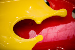 Closeup of 3D flowing yellow and red paint Royalty Free Stock Image