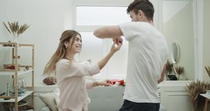 Closeup dacing couple in living room wearing pajamas very cute atmosphere cozy decorations. stock video