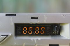 Digits Set On Zero. Closeup of damaged abstract device with digits set on zero stock photos