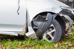 Closeup damaged front wheel and bumper on green grass, safety co Stock Photos
