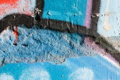 Closeup of a damaged graffiti wall Royalty Free Stock Photography