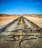 Closeup of the damaged historic Route 66 stock image