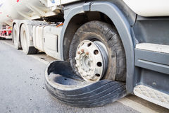Closeup damaged 18 wheeler semi truck burst tires by highway str Stock Photos