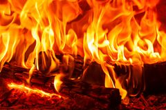 Closeup dancing burning firewood in the fireplace, fire and flames Stock Photos