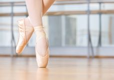 Closeup of dancing legs of ballerina in pointes. Closeup of dancing legs of ballerina wearing white pointes in the dancing hall stock photos