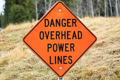 Closeup of a danger overhead power line sign.  royalty free stock images