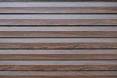 Closeup of brown polished wooden wall Royalty Free Stock Photo