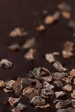 Closeup dark chocolate with pieces of cocoa beans Stock Photos