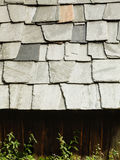 Closeup of dark grey stone roof tiles Royalty Free Stock Photos
