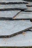 Closeup of dark grey stone roof tiles Stock Images
