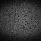 Closeup of dark grunge textured wall with  vignetting, may use a. S background with copy space for text Stock Images