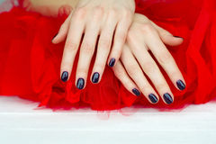 Closeup Dark Manicure On Red Royalty Free Stock Photos