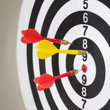 Closeup of dart board with arrows. Concept of hit the target Royalty Free Stock Photos