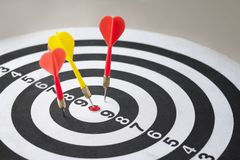 Closeup of dart board with arrows. Concept of hit the target Royalty Free Stock Images